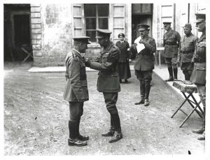 His Majesty The King decorates the Reverence T B Hardy, Army Chaplain, in 1918